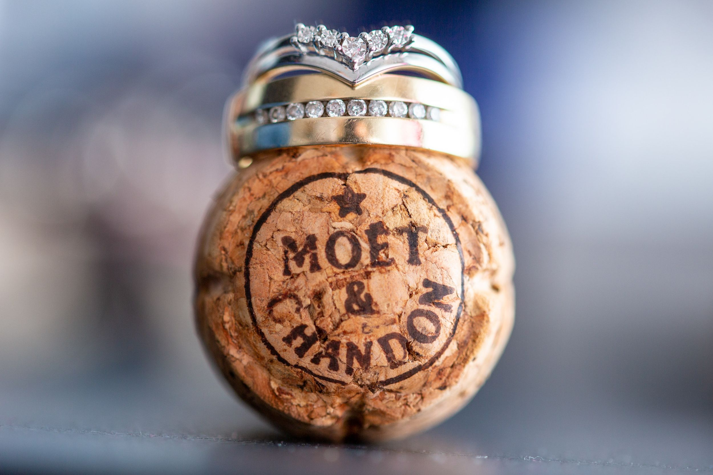 Wedding rings on Moët & Chandon champagne cork