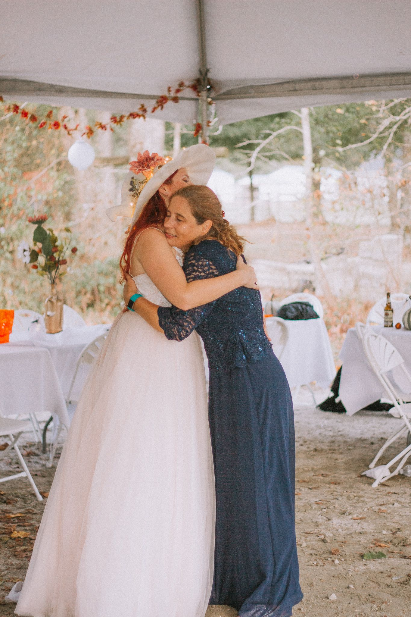 bride hugging her mom during her reception