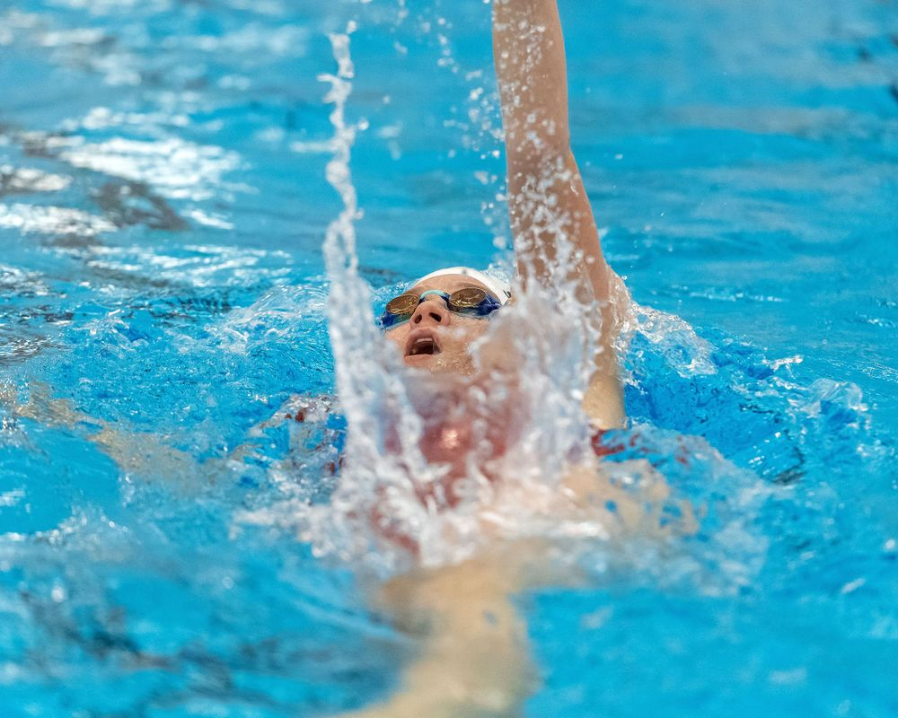 Girls high school swimming the backstroke