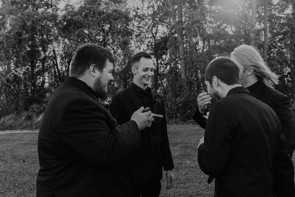 groomsmen smoking cigar