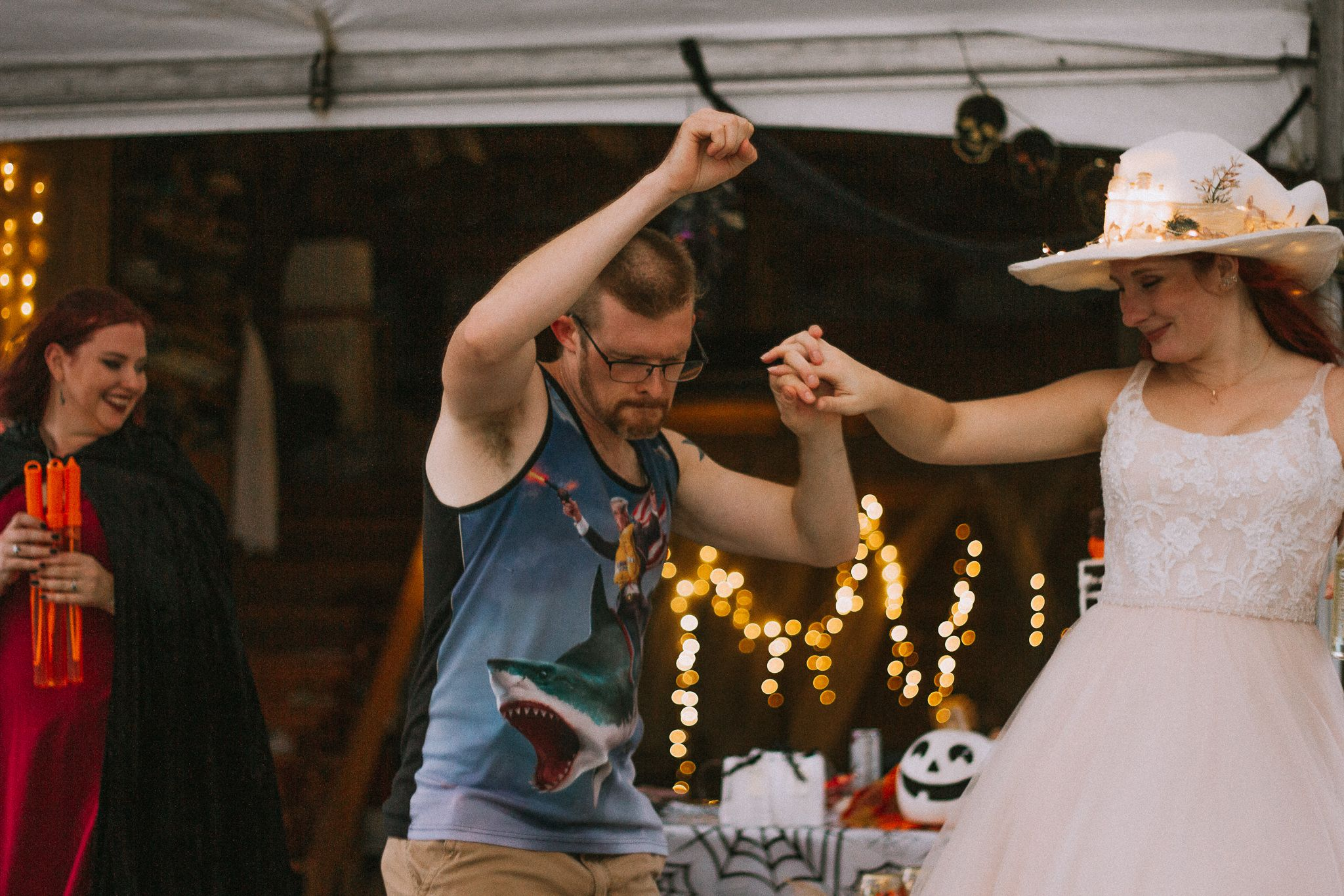 groom showing off his move in front of bride