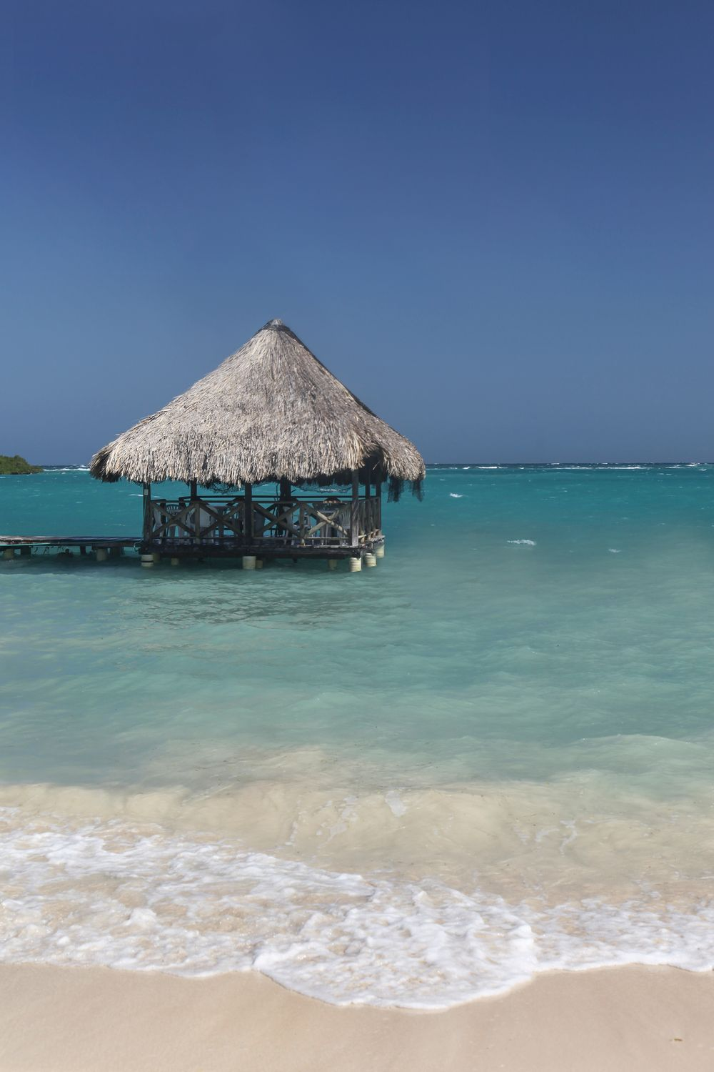 Beach shack on the blue ocean in Cartagena Colombia