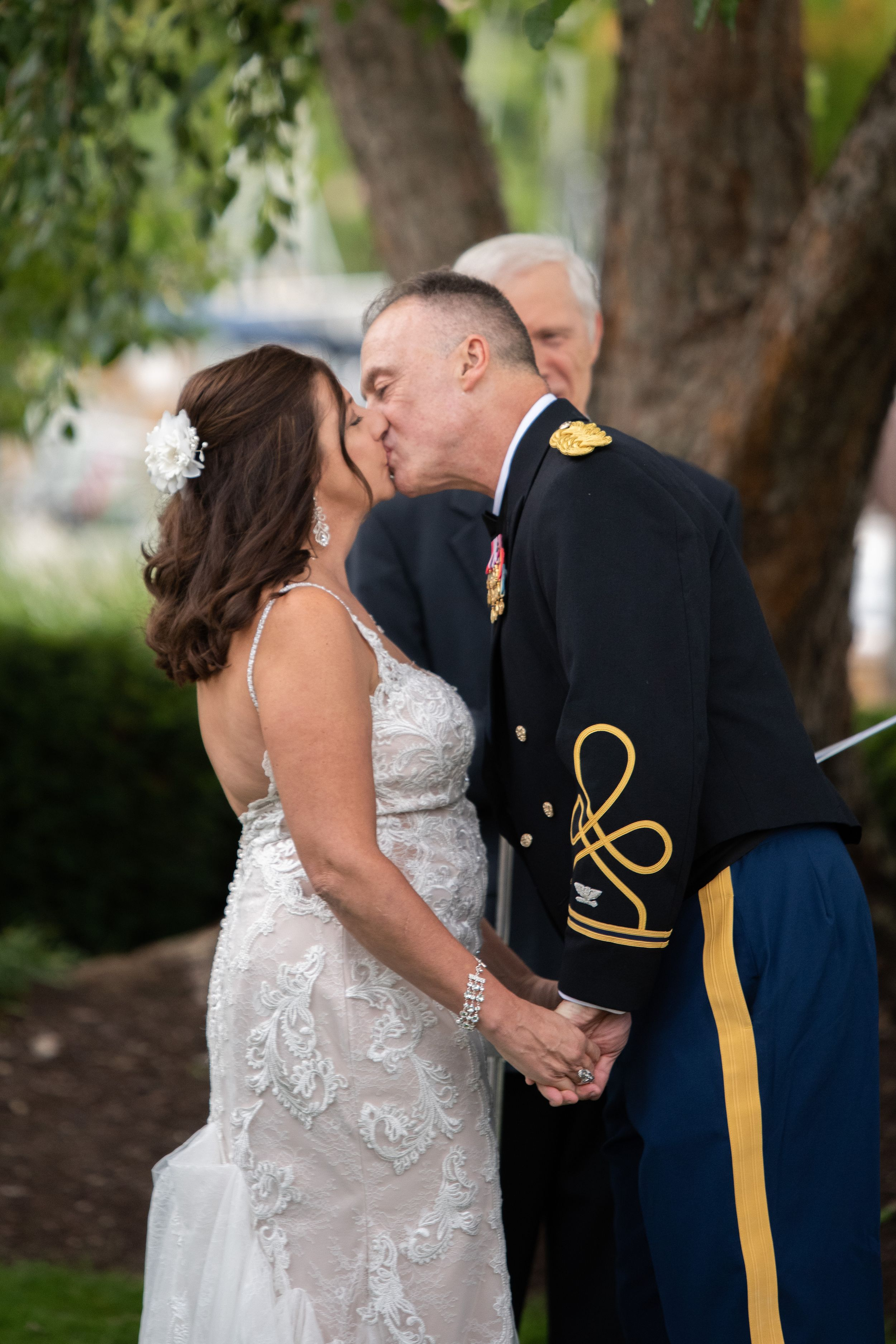 first kiss at outdoor wedding, Cleveland Yachting Club, Ohio