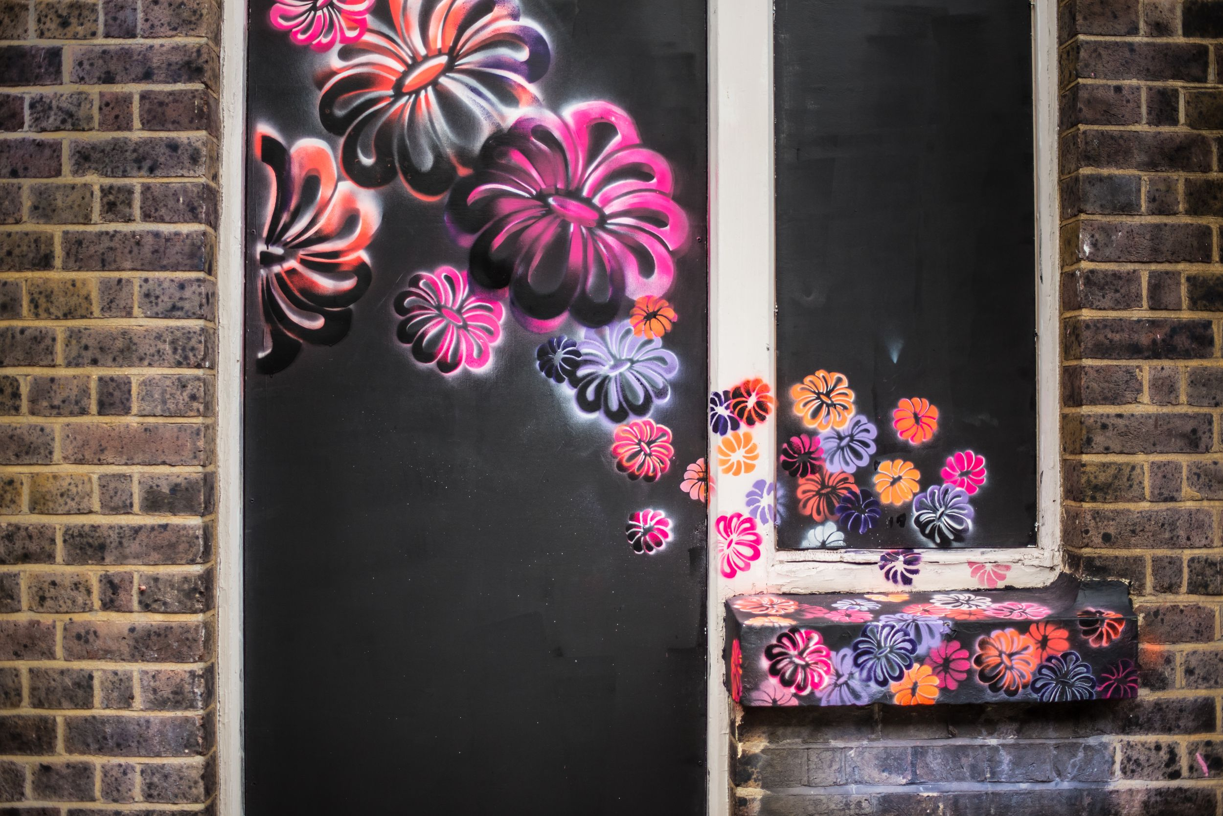 Flower power graffiti wall in London's Shoreditch neighborhood