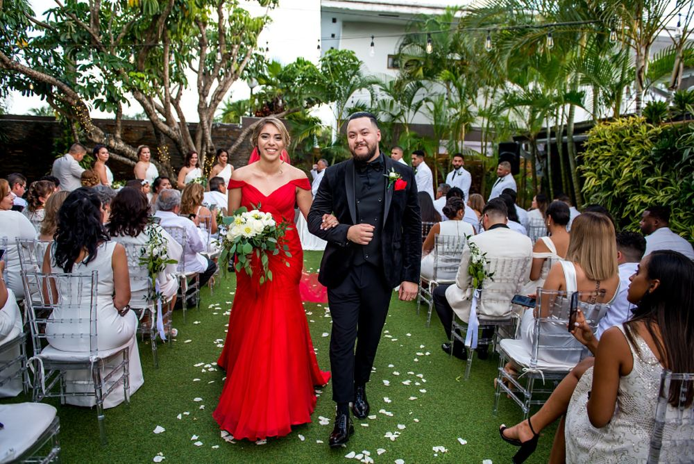 Club of Knights Coral Gable wedding, bride in a red wedding gown, groom donned a black tuxedo