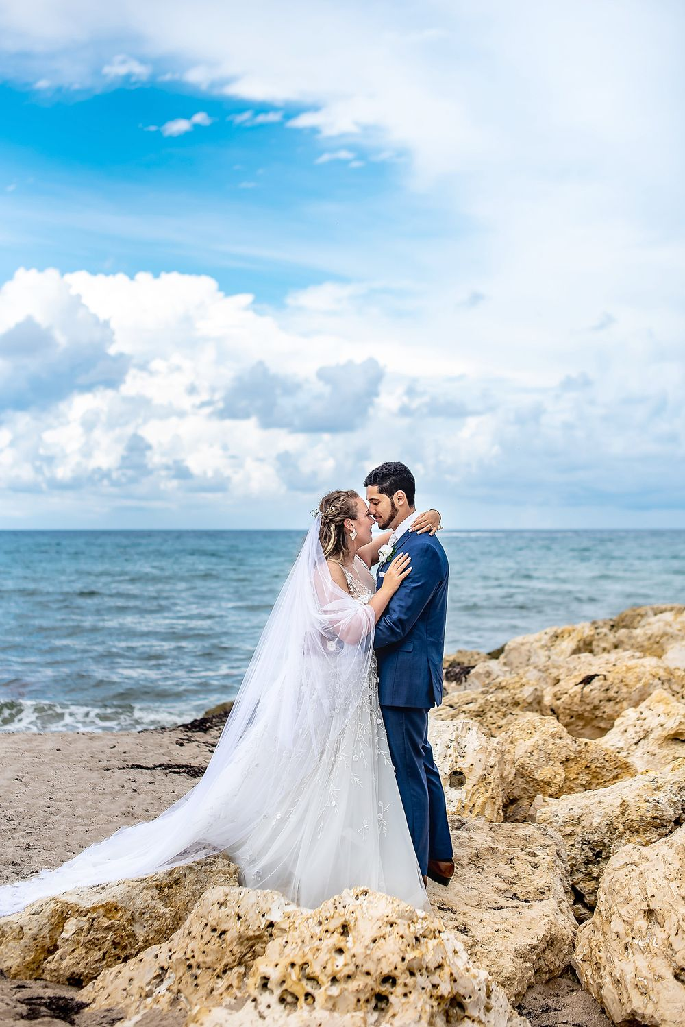 The Sailfish Club of Florida wedding, bride and groom beach portrait, lace wedding gown