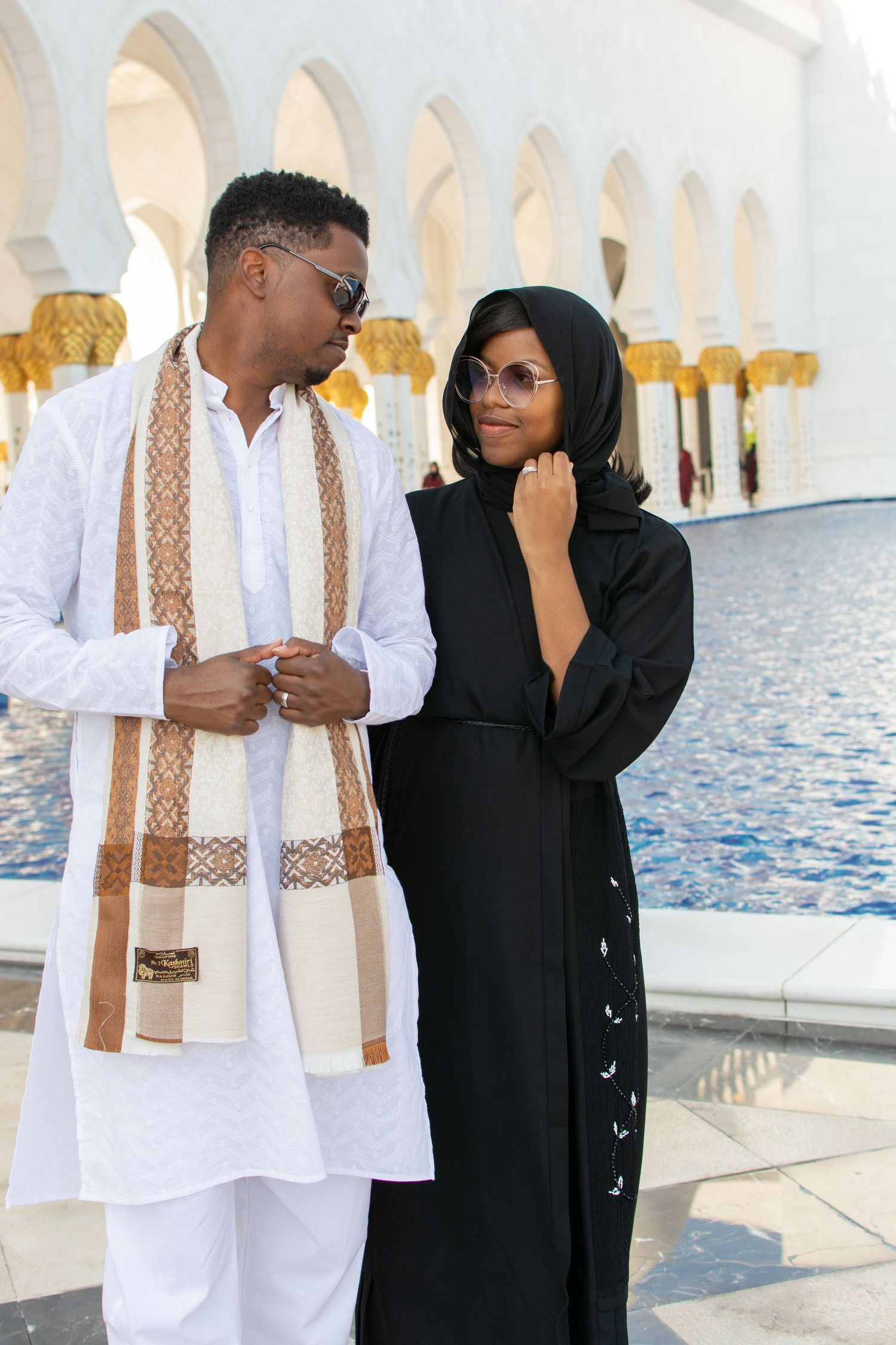 Black couple visits the Great Mosque in Abu Dhabi. Elopement and adventure photo by Gernelle Nelson