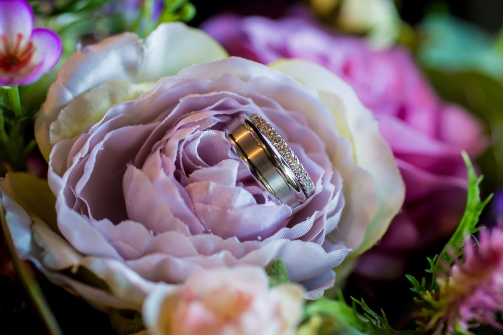 Wedding rings in a bouquet before a wedding ceremony at Stone River in West Columbia, SC