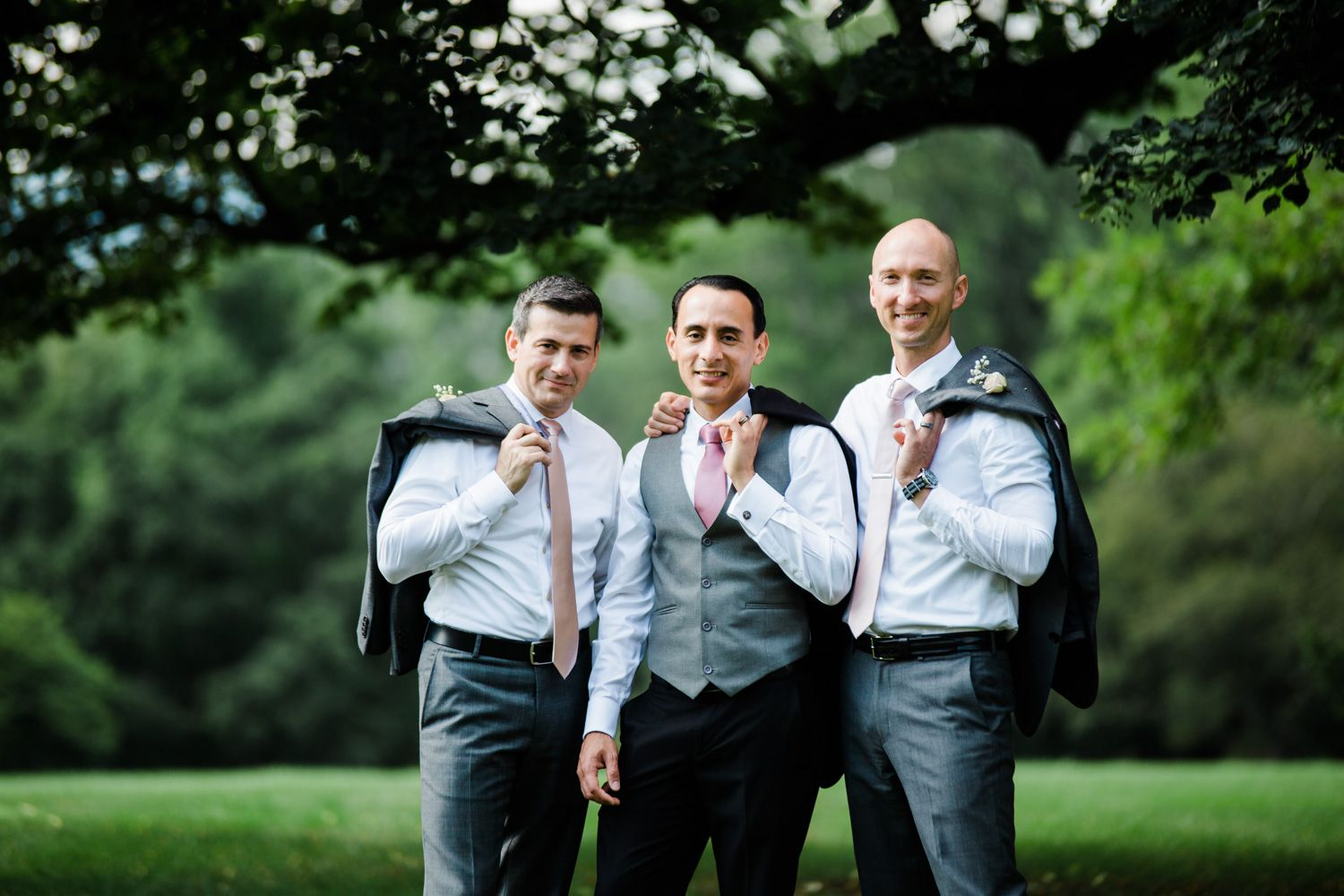 Groom and groomsmen in casual pose at Skylands Manor in New Jersey