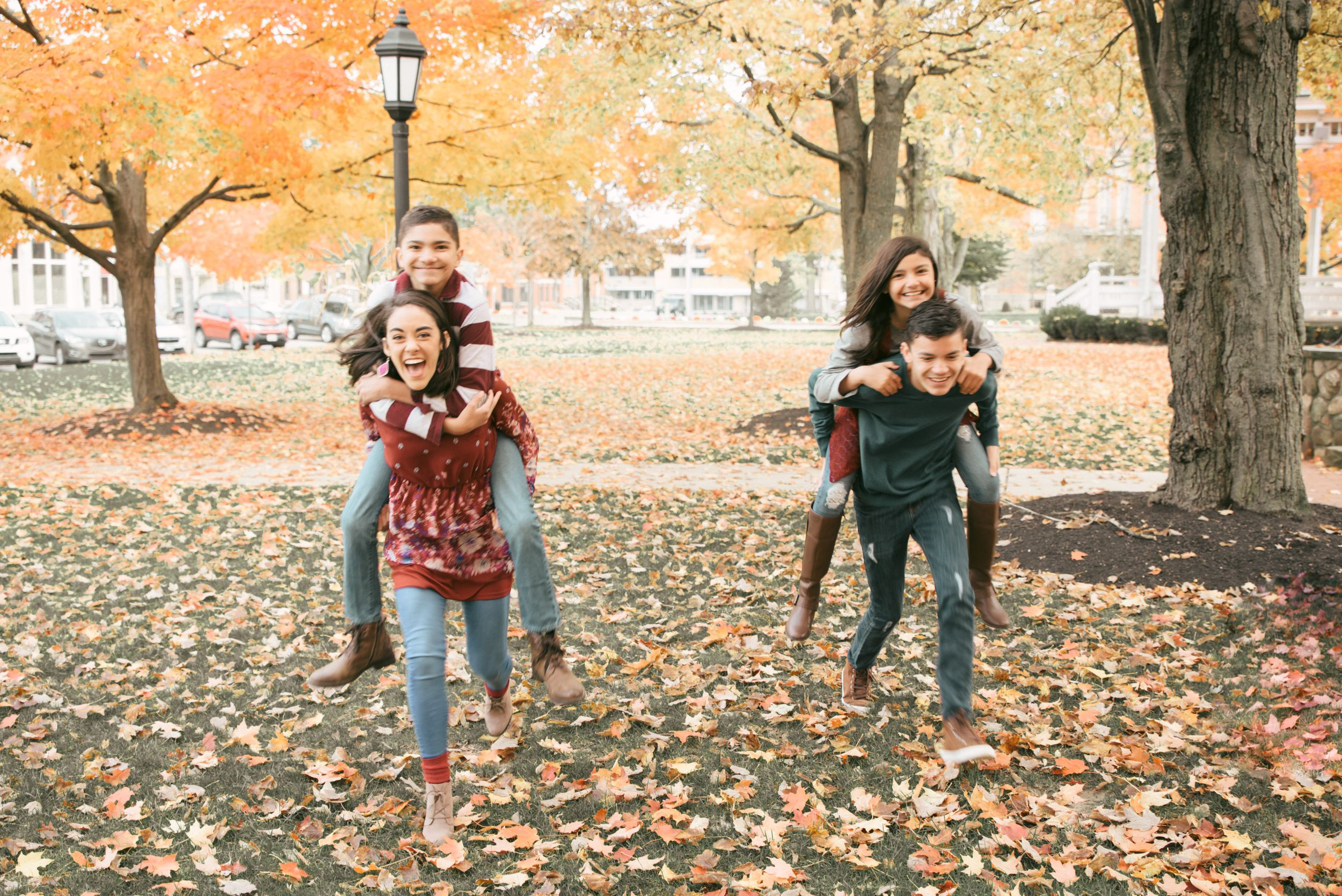 family of six pose, Chardon Square in fall, Chardon , Ohio