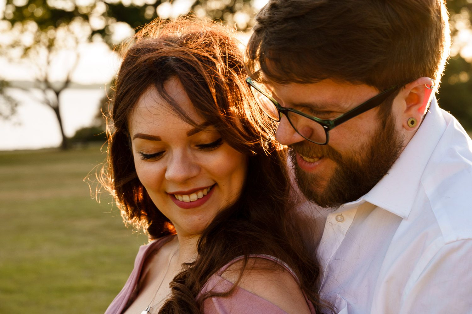 Close up of happy couples' faces at their Southampton maternity photoshoot.