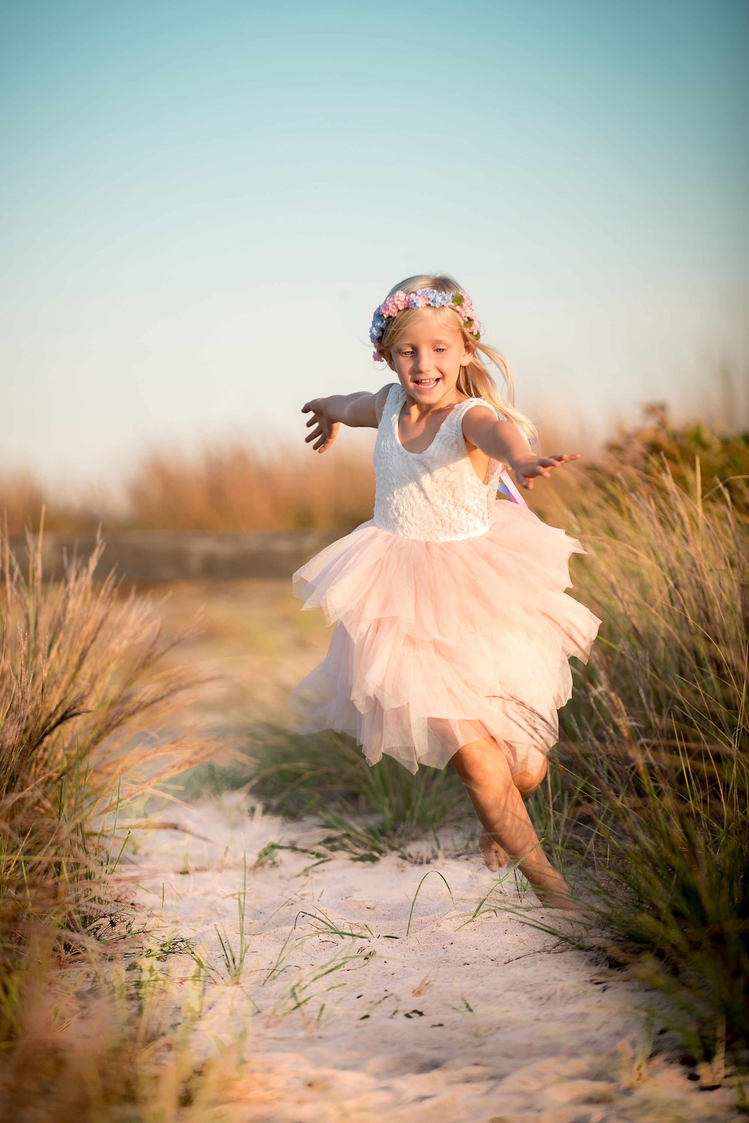 Plymouth MA beach portraits by heidi harting photography. Young girl running on the beach in a fairy costume
