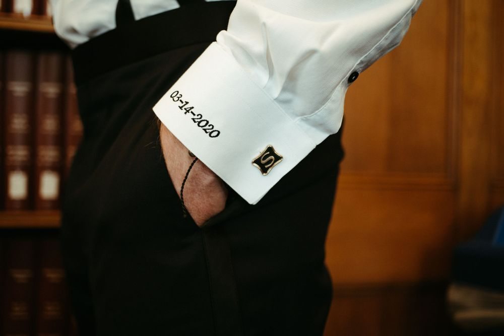 groom-cufflinks-and-wedding-date-wedding-cowles-library-desmoines-iowa-raelyn-ramey-photography