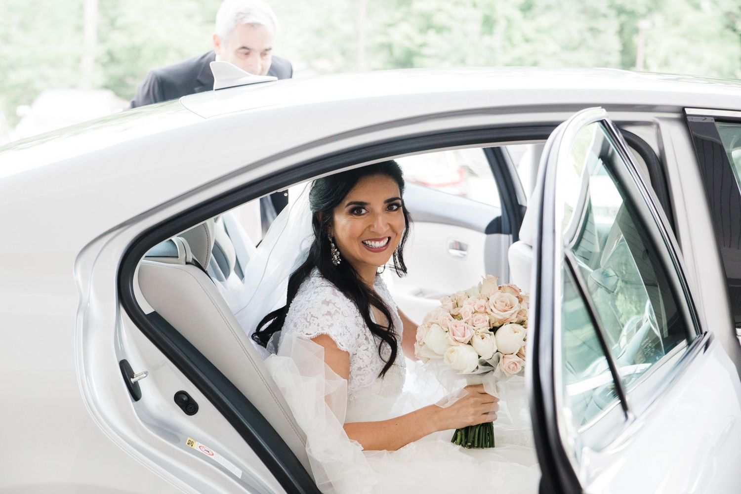 Hudson Valley bride pulling up to ceremony in car