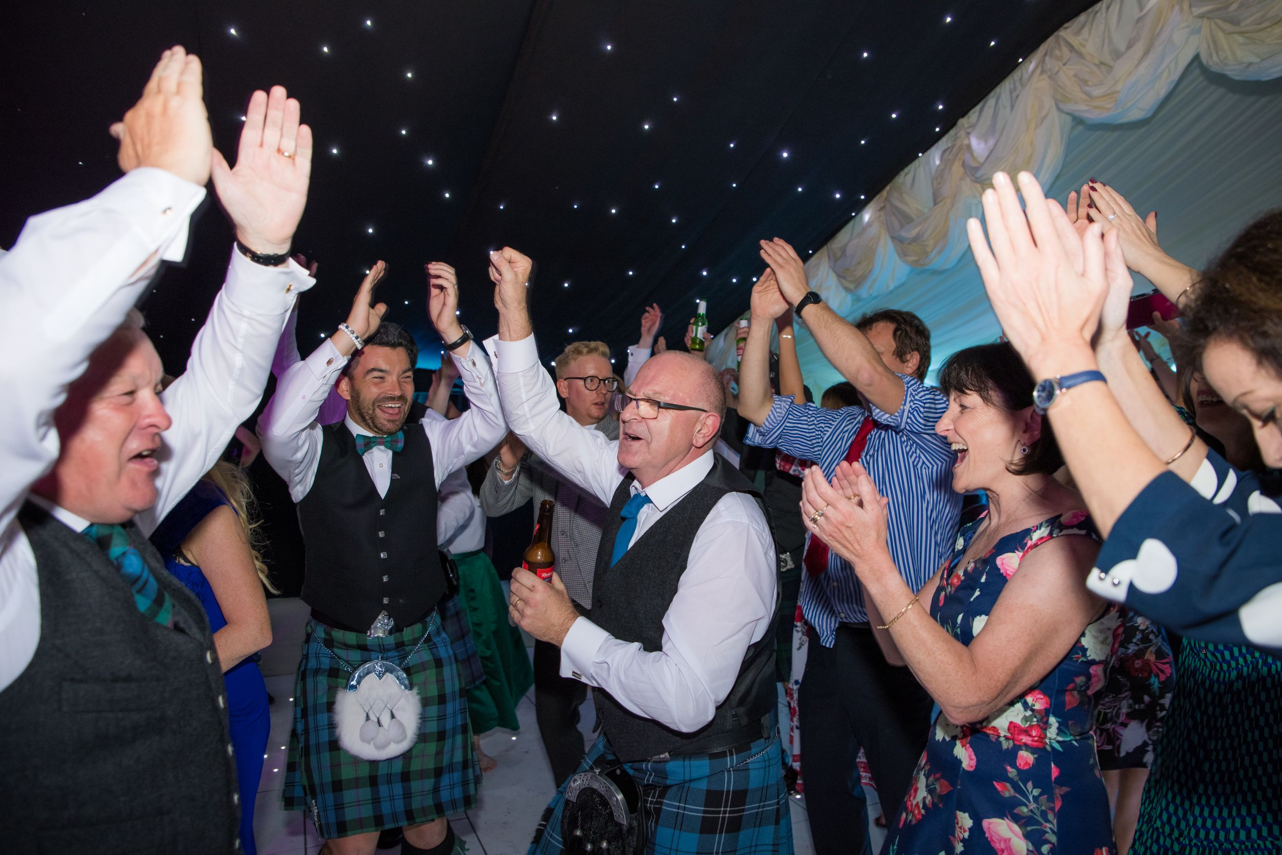 wedding guests in kilts partying, Robert Nelson Wedding Photography