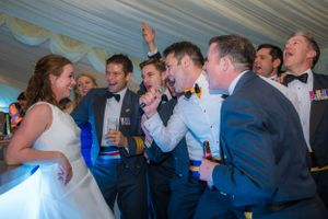 top gun UK RAF soldiers airforce signing to the bride at the bar, Robert Nelson Wedding Photography
