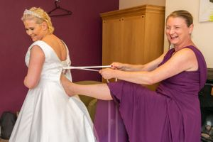 bride squeezing in to her dress, Robert Nelson Wedding Photography