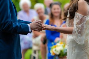 groom putting the brides ring on her finger, Robert Nelson Wedding Photography