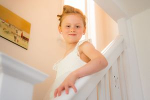 flower girl on the stairs at home, Robert Nelson Wedding Photography