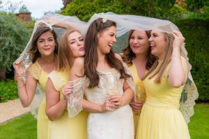 bride and bridesmaids under the brides veil, Robert Nelson Wedding Photography