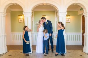 children covering their eyes as mum and dad kiss during wedding photos , Robert Nelson Wedding Photography
