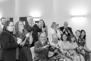 wedding guests on mobile phones at ceremony - Aubrey Park Hotel St Albans