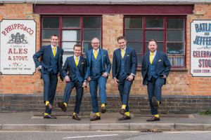 groomsmen pulling up their trousers to show yellow socks, Robert Nelson Wedding Photography