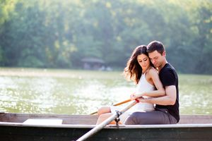 couple rowing on engagement photography session