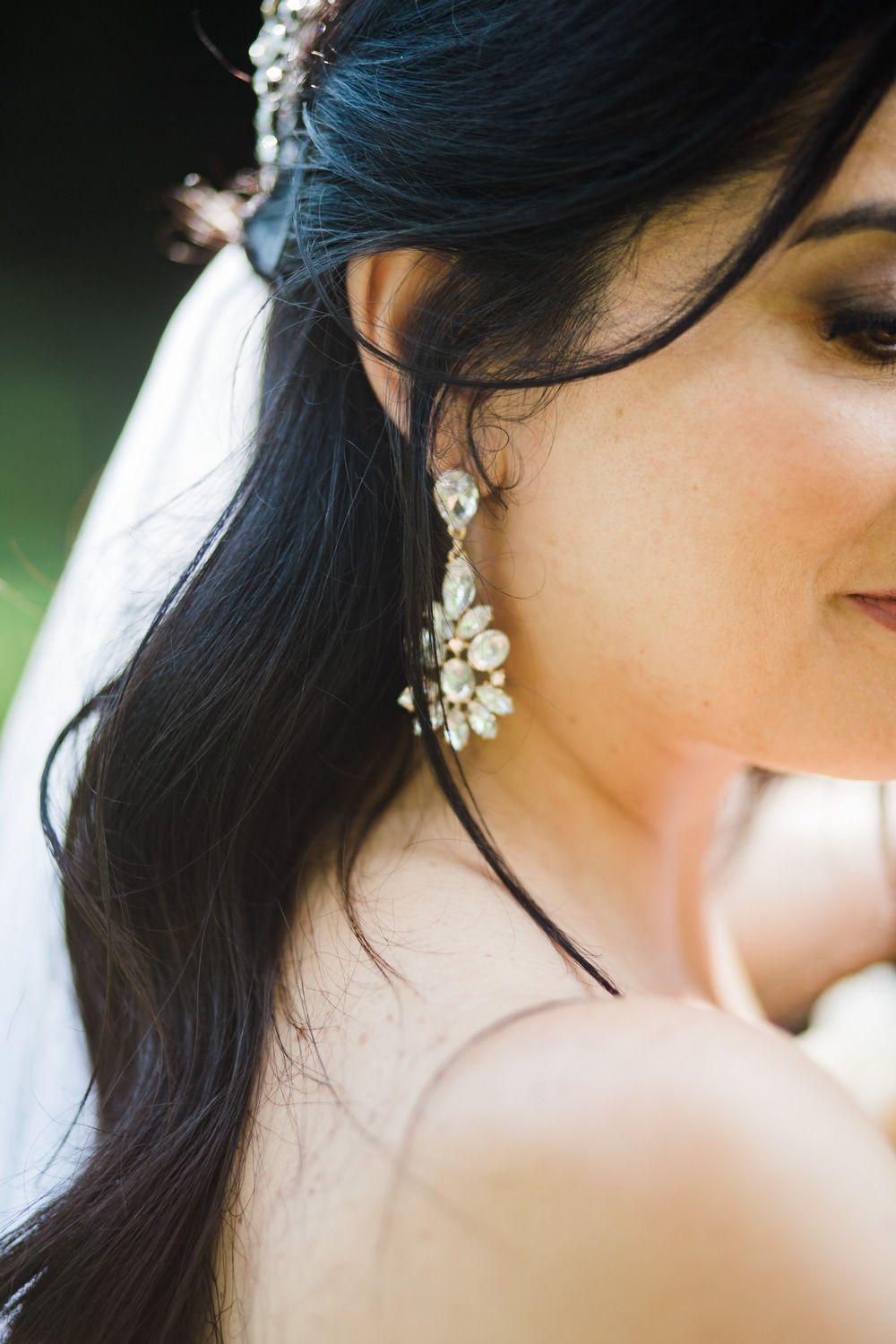 Closeup of bride wearing crystal earrings