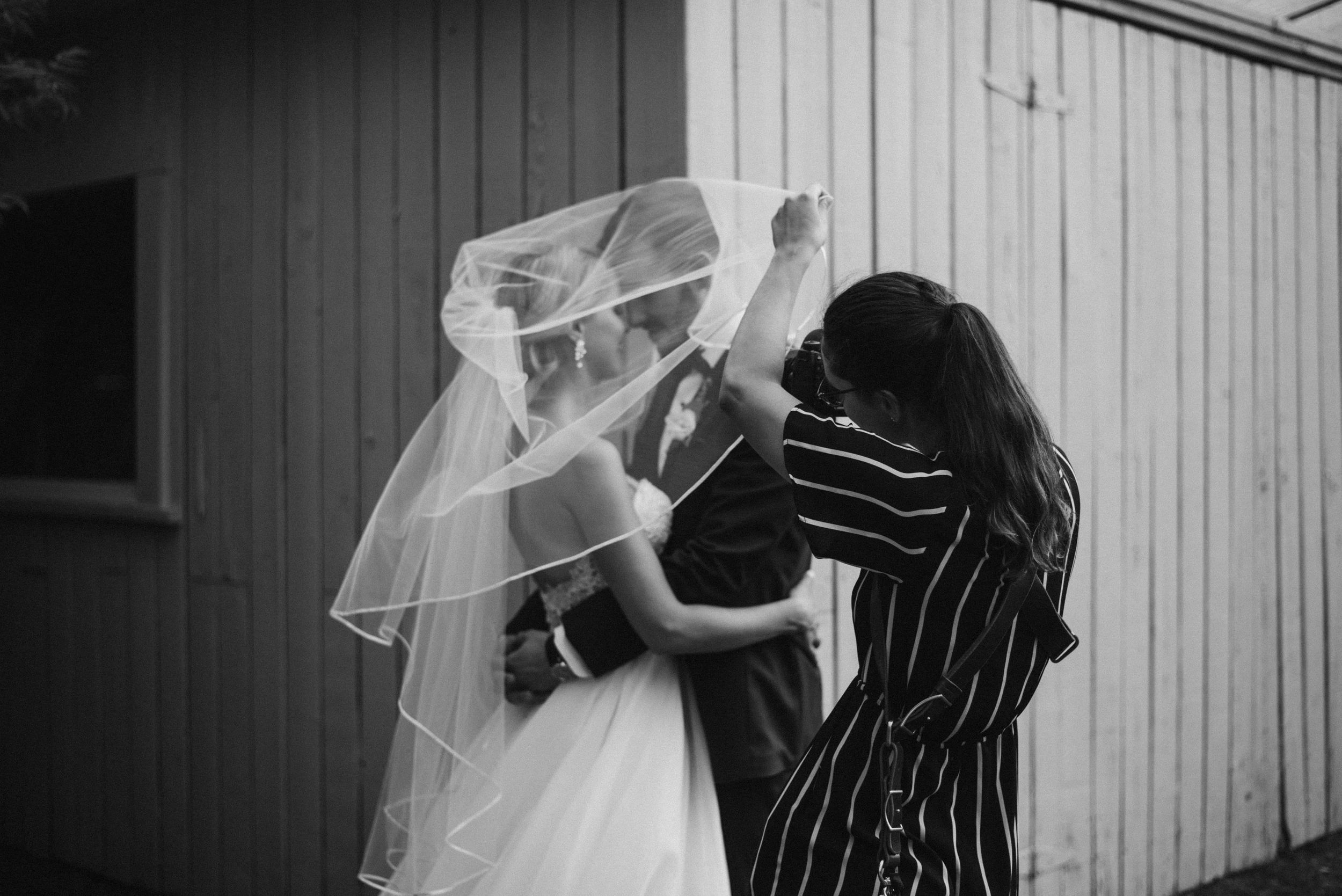 Raphaelle Granger working on an epic veil shot for bride and groom