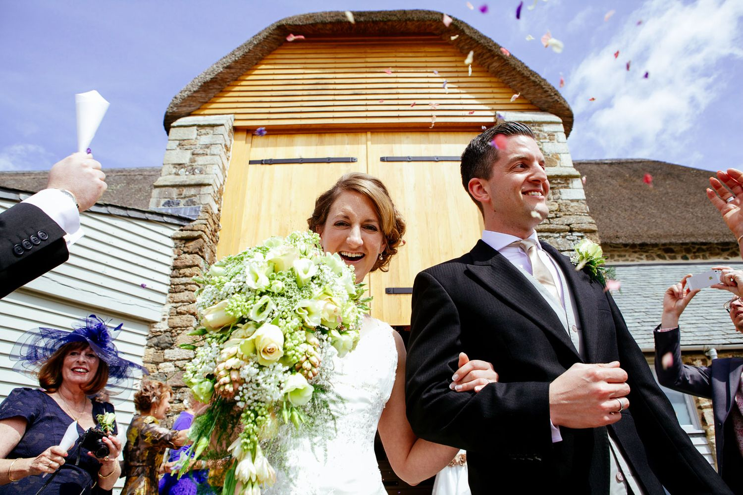 natural confetti wedding photography at Great Barn Devon
