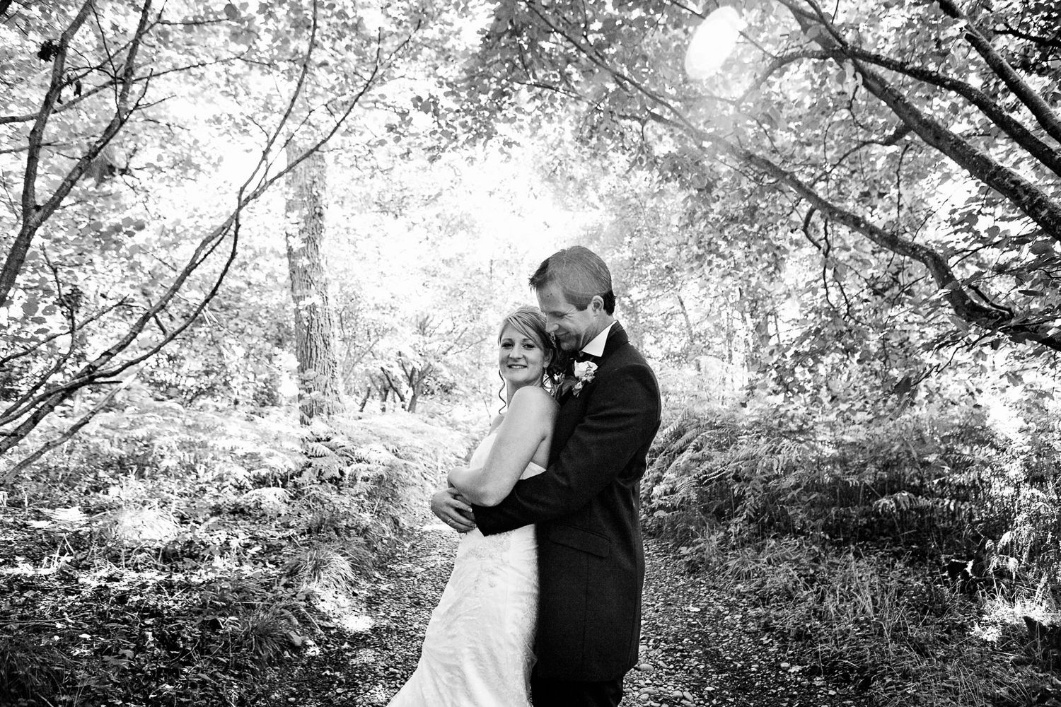 black and white couples portrait in woods at Devon wedding