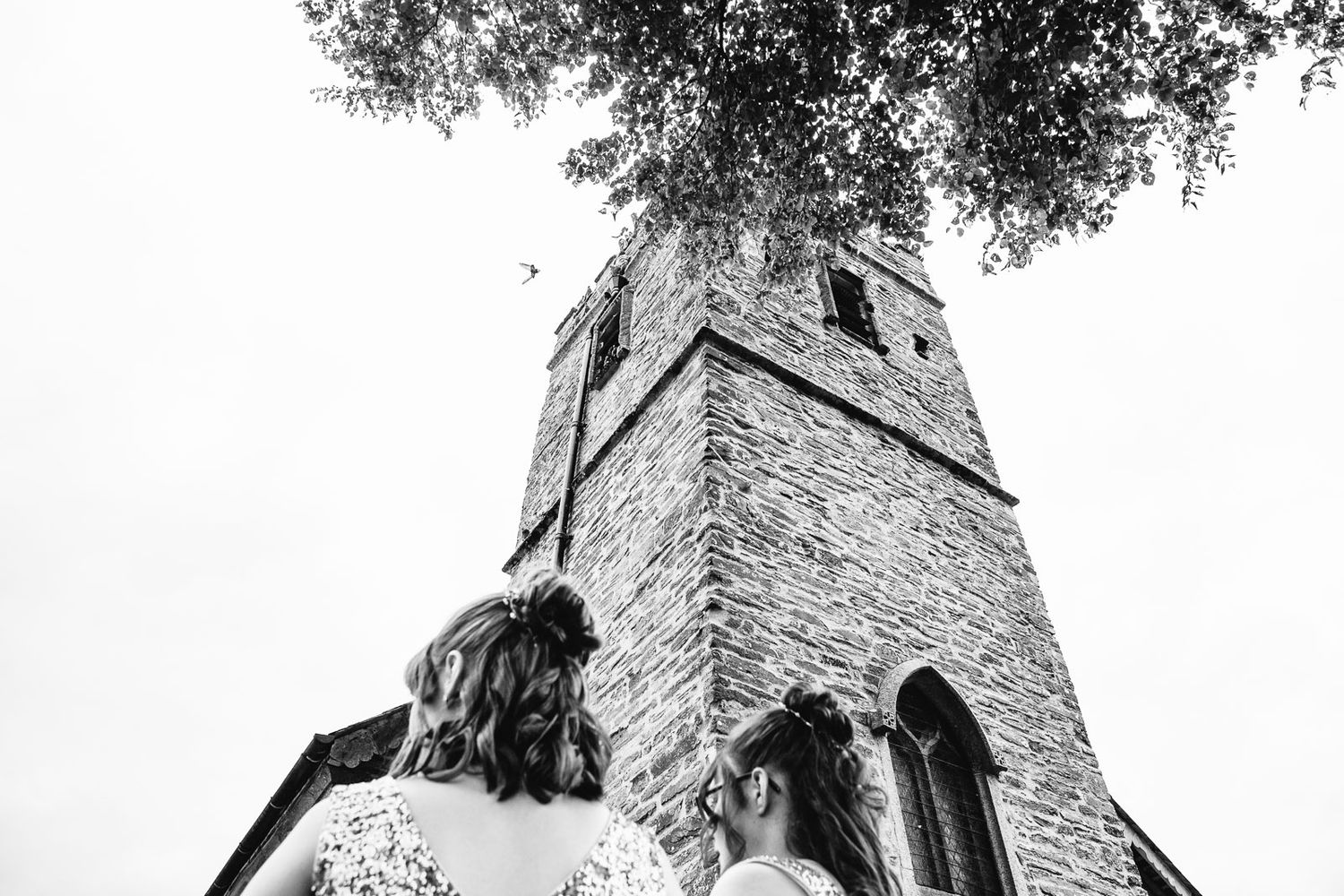 creative wedding photography in Devon view up church tower