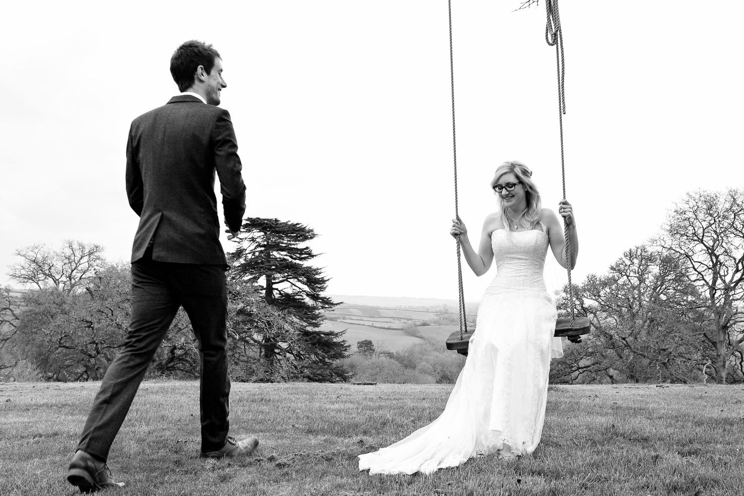 bride on swing vintage style wedding in Devon