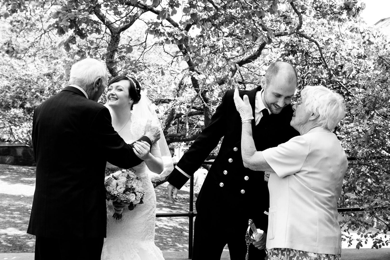 natural wedding photography of bride and groom with grandparents by Tuscany destination wedding photographer