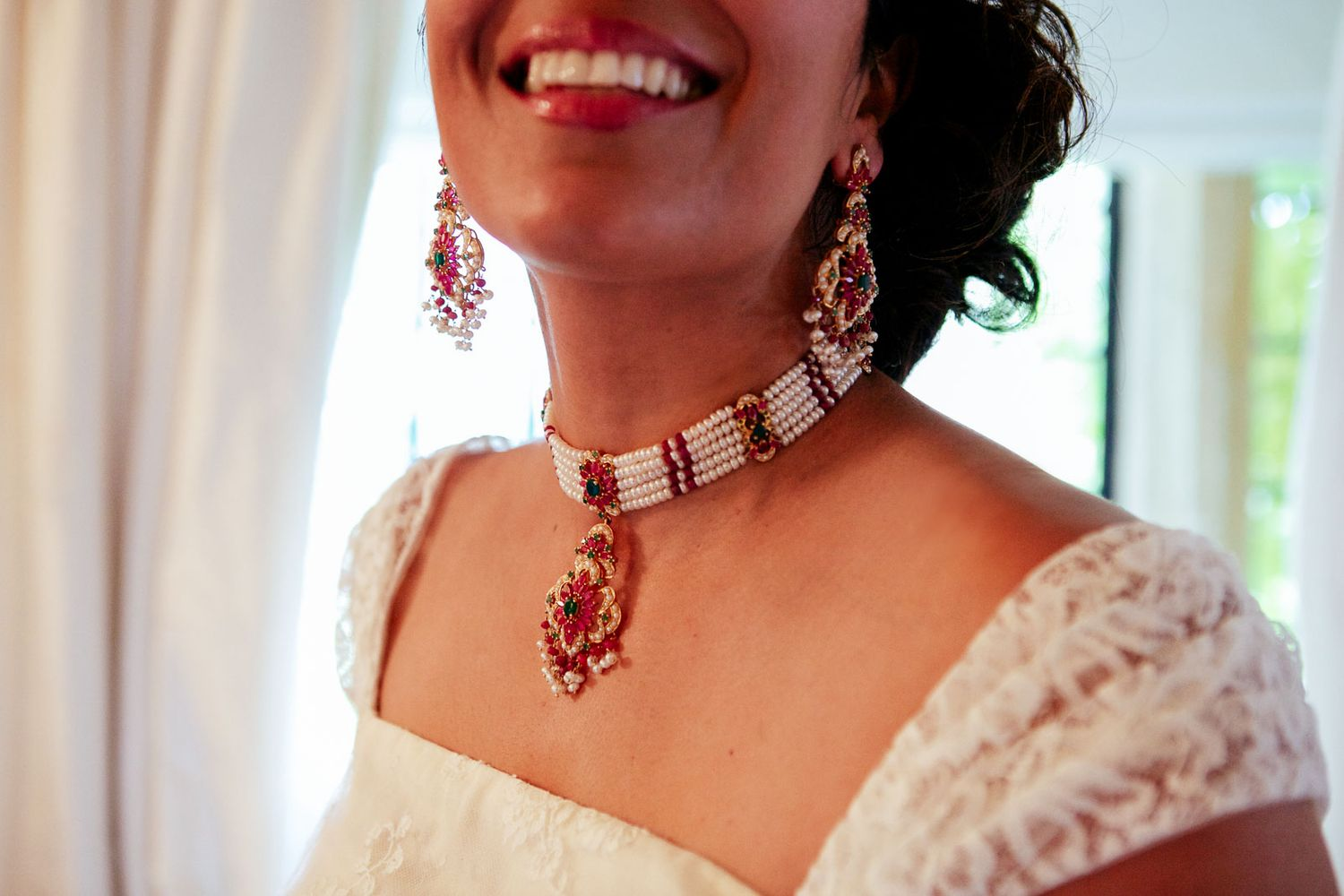 bright and beautiful bride smiling by wedding photographer in Tuscany
