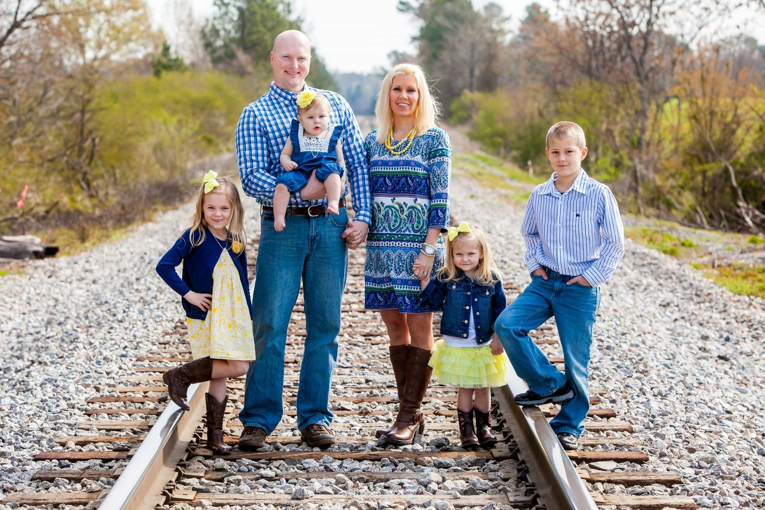 Family portrait on railroad train tracks photo by Columbia, SC, wedding photographer Jeff Blake