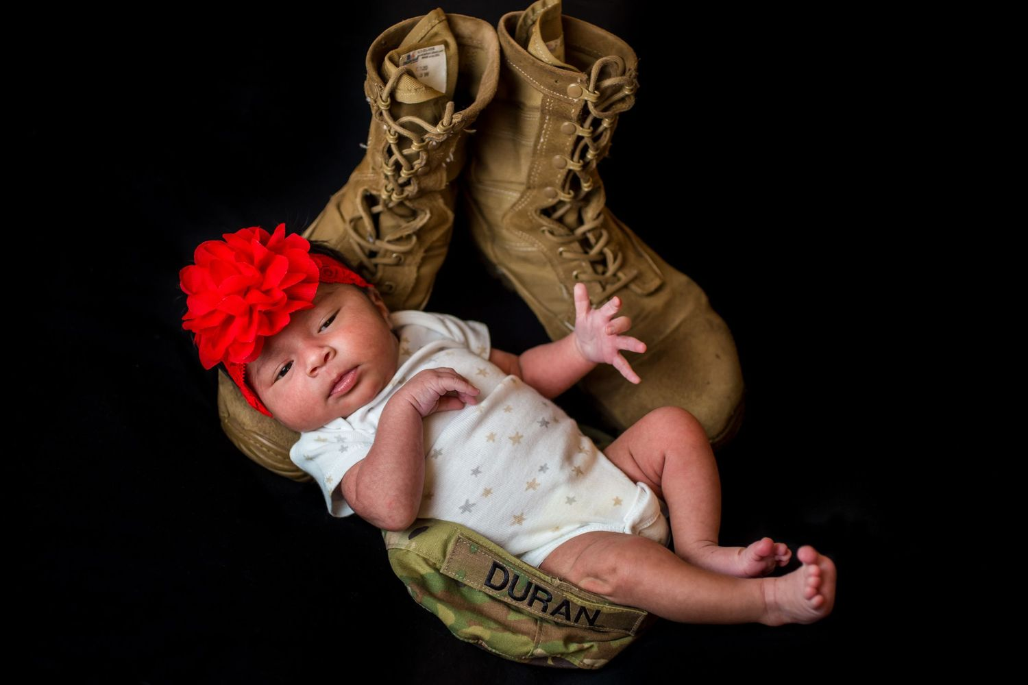 Newborn baby portrait in Army soldier dad's hat and boots by Columbia, SC, Wedding Photographer Jeff Blake