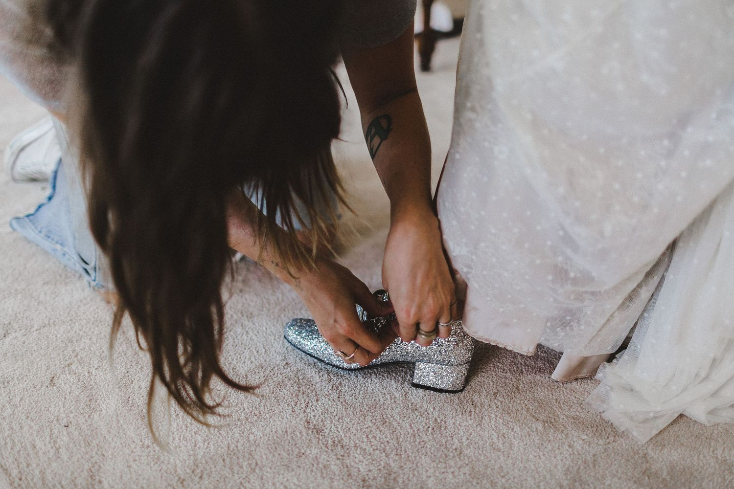 putting on shoes for bride