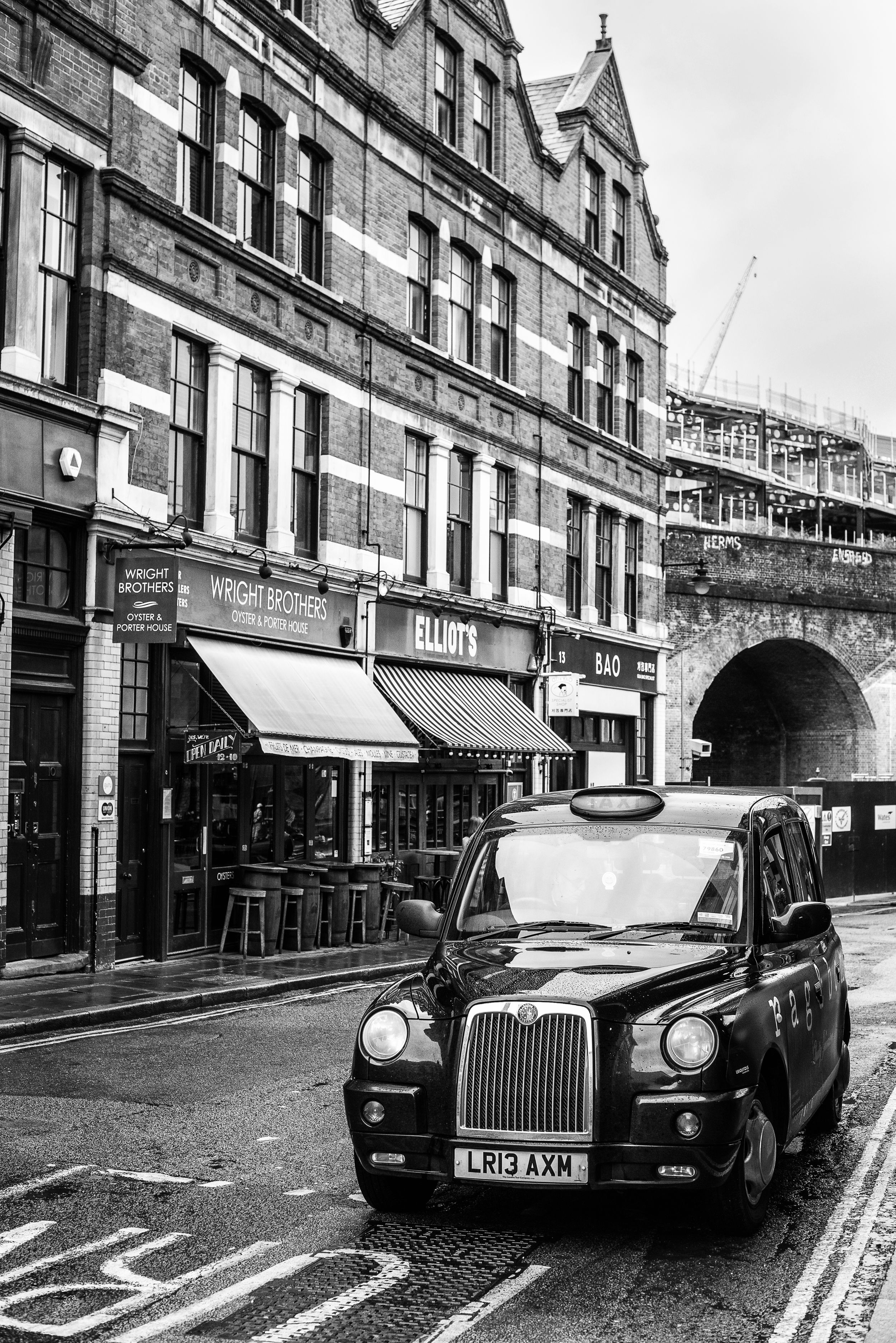 black and white street image of a London taxi in Boroughs Market area