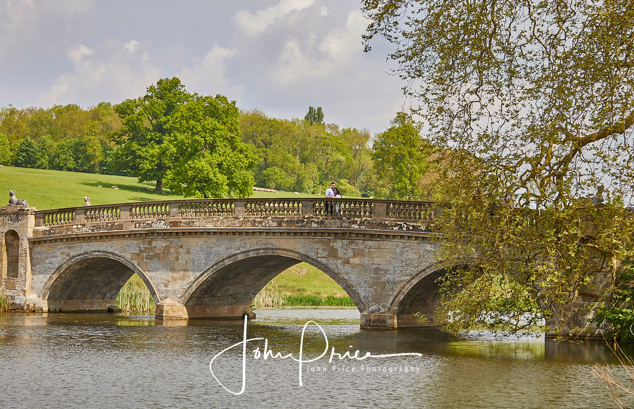 clumber park bridge with couple posing