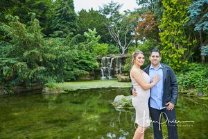 engaged photo at highfields boating lake by waterfall
