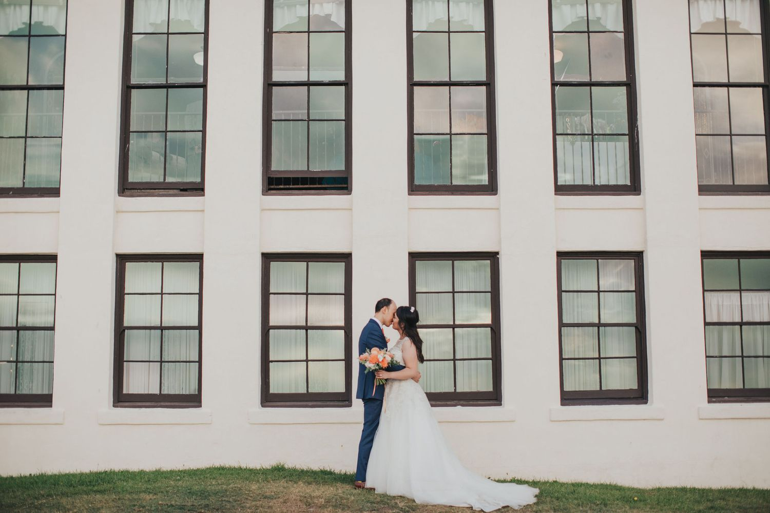 bride & groom in front of windows redondo beach historic library