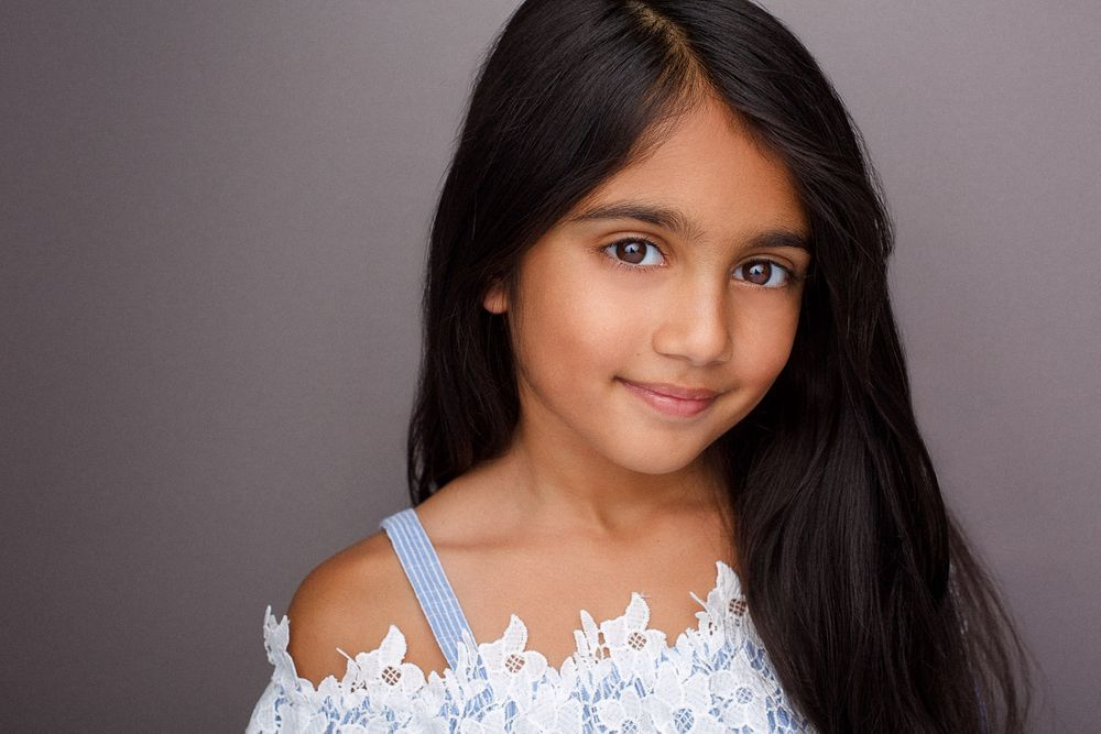 headshots nyc of kid actor in white lacey top
