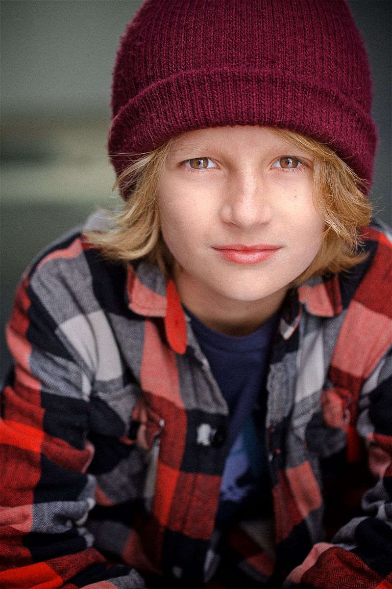 headshots nyc of kid actor in maroon sock hat