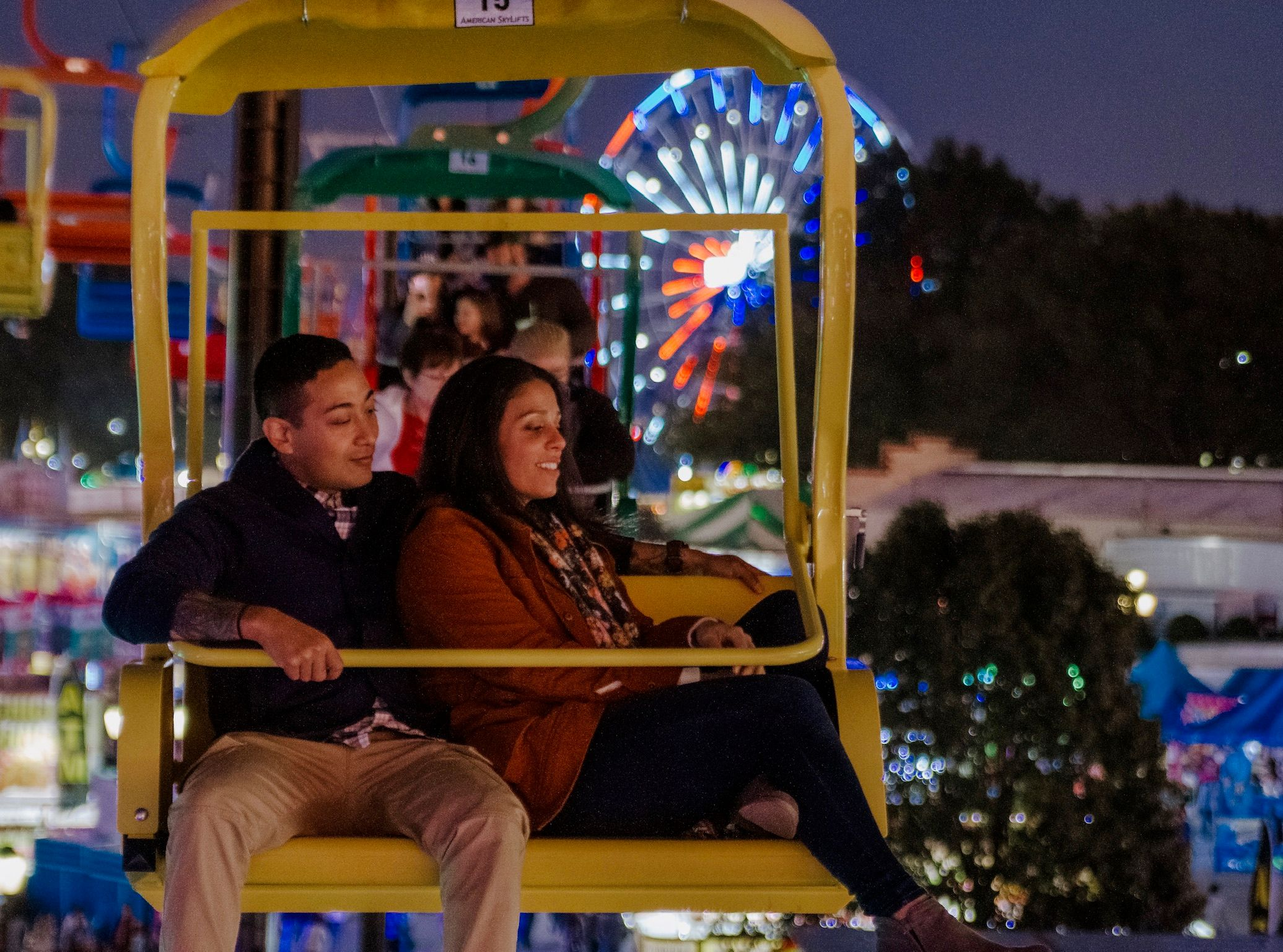 couple looking at the fair ground from the skii lift in raleigh north carolina