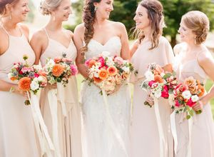 Bride and bridesmaids with colorful bouquets at HammerSky Vineyards wedding