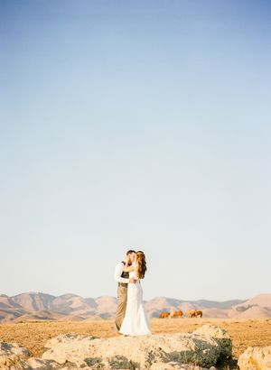 Bride and groom at sunset with horses at Pepper Tree Ranch wedding