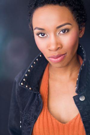 headshot of Marvel's Black Panther actress Carrie Bernans