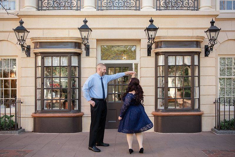 A couple twirling at the UK Pavilion at Walt Disney World's Epcot in Orlando FL